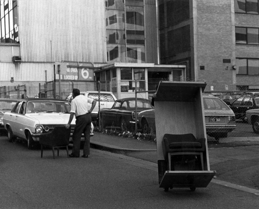 Men Moving Furniture Down Street on Trolley