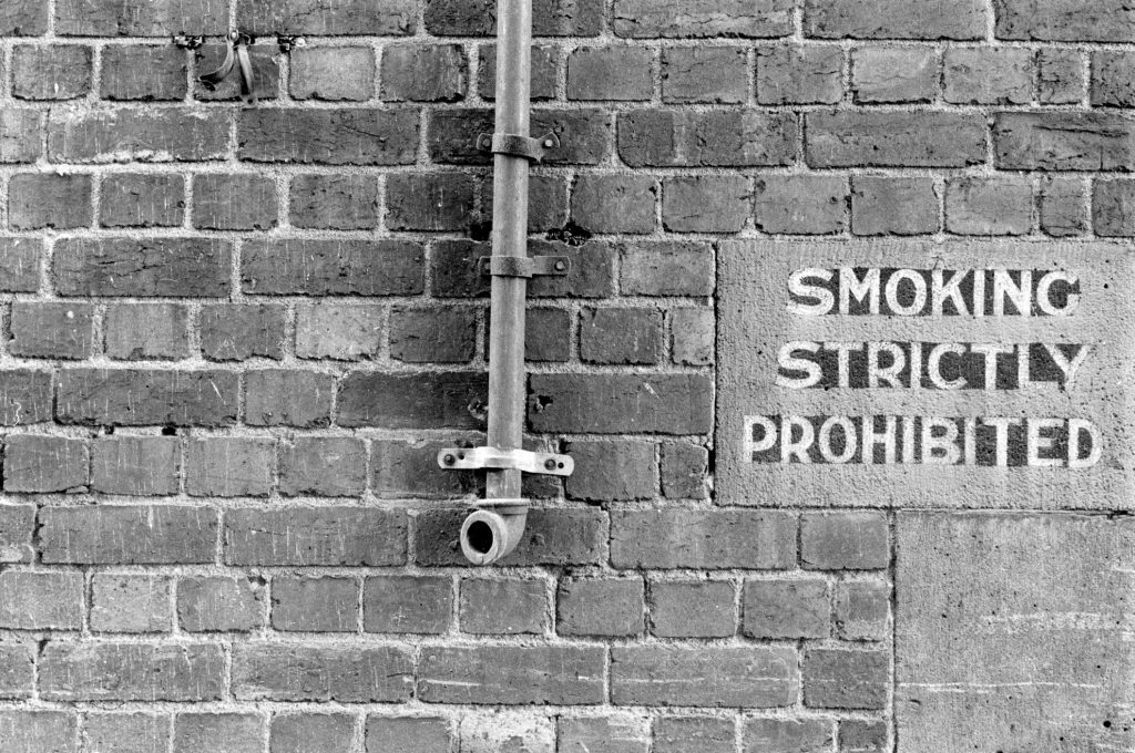 Brick Wall with Sign, 'Smoking Strictly Prohibited'